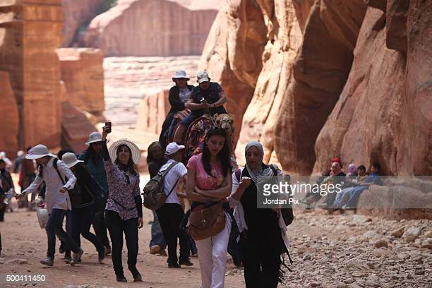 Tourists visit the legendary Petra Jordan's most famous tourist attraction on April 3 2015 in Petra Jordan Stakeholders have put together an urgent...
