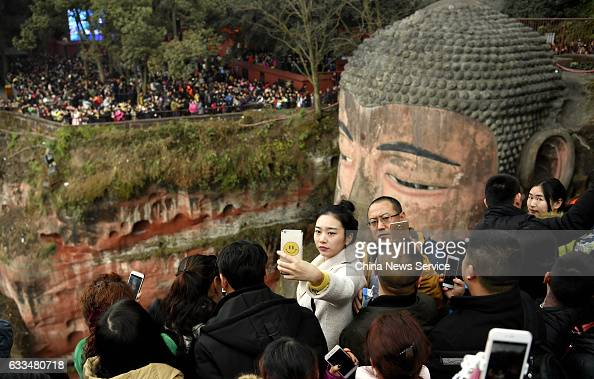 Tourists visit the Leshan Giant Buddha on the fifth day of Lunar New Year on February 1 2017 in Leshan Sichuan Province of China