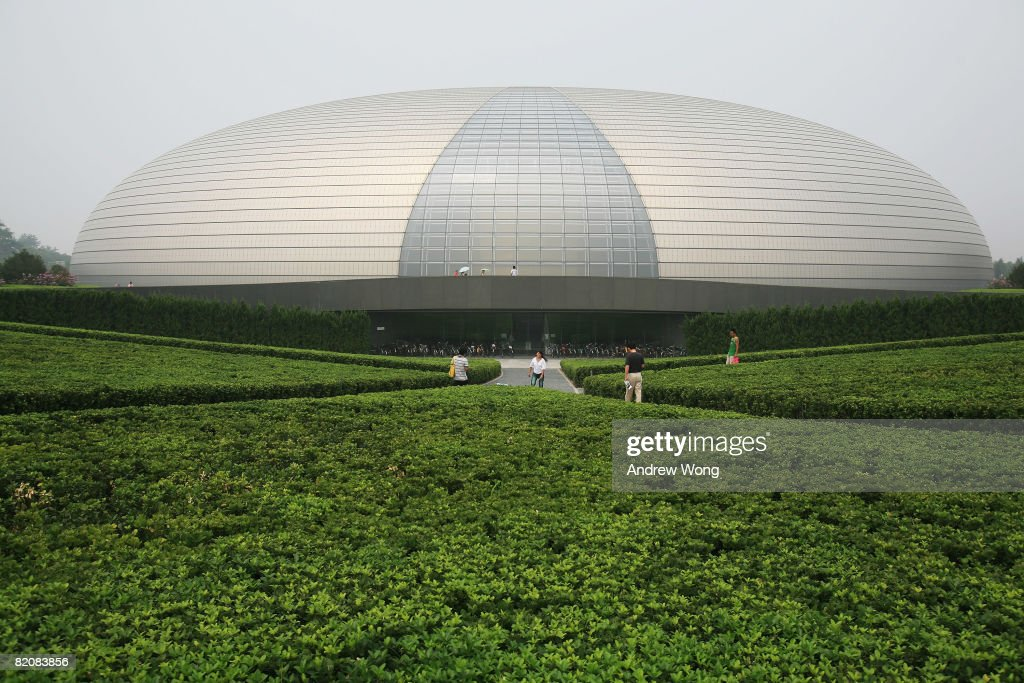 Tourists visit the National Centre for the Performing Arts on July 28, 2008 in Beijing, China. The 'Egg', as it is known to the local people, is located to the west of the Tiananmen Square and the Great Hall of the People. The Beijing Olympic Games start on August 8.