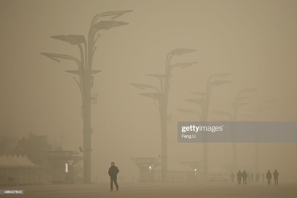 Tourists visit the Olympic Park during dheavy smog on December 1 2015 in Beijing China The representatives of the governments of more than 190...