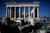 Tourists visit the Parthenon Temple at the Acropolis hill in Athens on February 21 2015 Greece's radical left government was at pains to put a...