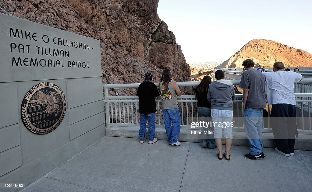 Tourists visit the pedestrian plaza at the Mike O'Callaghan-Pat Tillman Memorial Bridge part of the Hoover Dam Bypass Project October 26, 2010 in the Lake Mead National Recreation Area, Nevada. The 1,900-foot-long structure sits 890 feet above the Colorado River, about a quarter of a mile downstream from the Hoover Dam. The USD 240 million four-lane bypass project to relieve vehicle traffic on the Hoover Dam began in 2003, and opened to traffic on October 19.