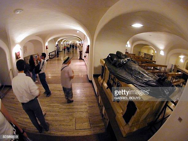 Tourists visit the Popes' crypt of the St Peter Basilica at the Vatican 28 May 2001 Pope John Paul II did not leave instructions concerning his...