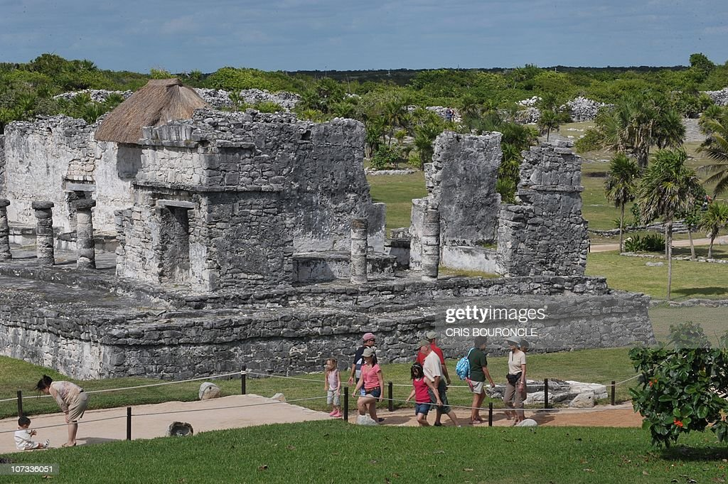 Tourists visit the PreColumbian Mayan site of Tulum built on the eastern coast of the Yucatan Peninsula on the Caribbean Sea in the Mexican state of...