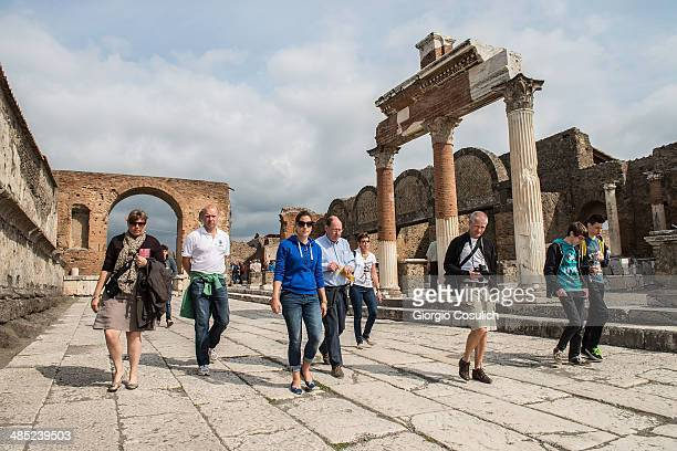 Tourists visit the ruins of the Foro at the archeological site on April 12 2014 in Pompei Italy The Italian government has enacted a series of...