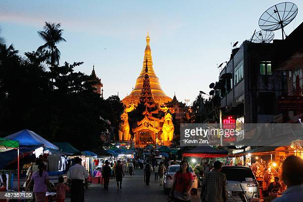Tourists visit The Shwedagon pagoda at night on June 2 2015 in Yangon Myanmar Myanmar's general election will be held in 2015 and the election is...