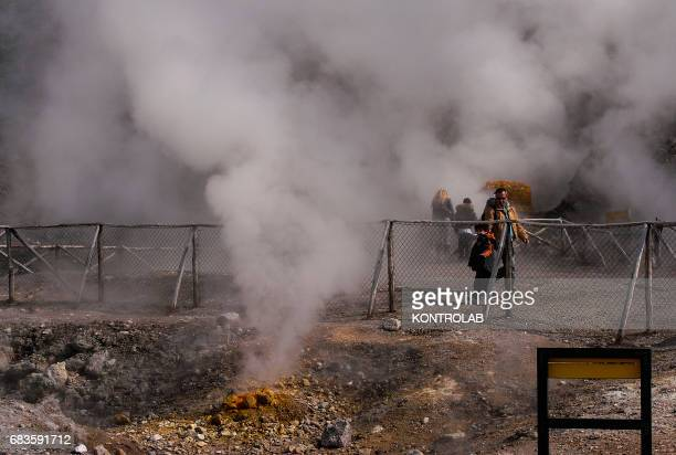 Tourists visit the Solfatara crater part of the Campi Flegrei Volcano the biggest caldera of Italy