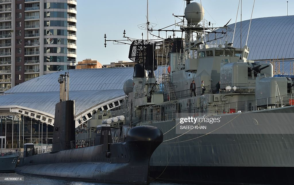 Tourists visit the submarine HMAS Onslow and the destroyer HMAS Vampire preserved as museum ships in front of the National Maritime Museum in Sydney...