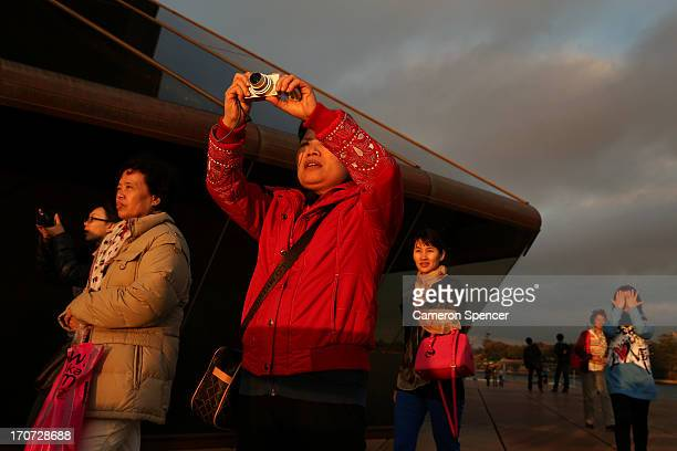 Tourists visit the Sydney Opera House on June 12 2013 in Sydney Australia The New South Wales government is expected to commit AUD $14 million in...