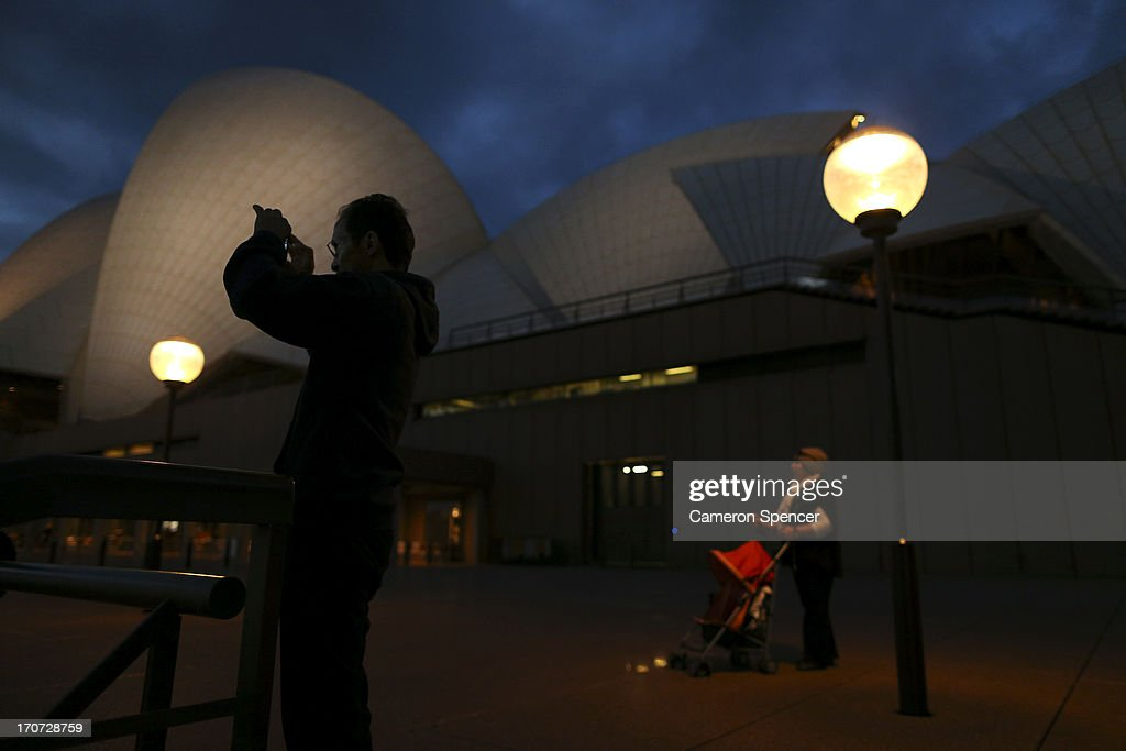 Tourists visit the Sydney Opera House on June 13, 2013 in Sydney, Australia. The New South Wales government is expected to commit AUD $14 million in it's 2014-15 budget to a ten year plan that will see the Sydney Opera House refurbished and it's facilities upgraded. The world-heritage listed landmark will celebrate it's 40th anniversary this October.