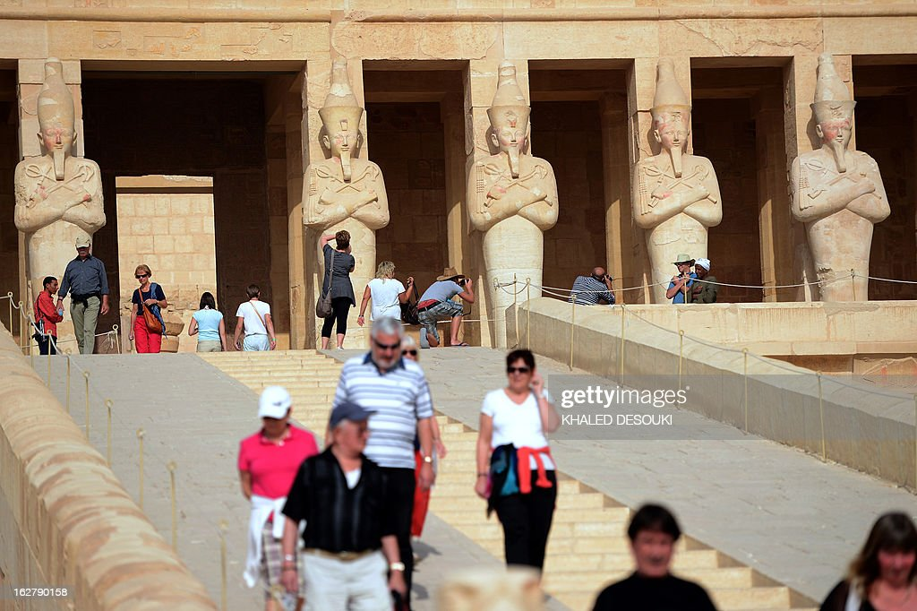 Tourists visit the Temple of Hatshepsut on February 27, 2013, in Egypt's ancient temple city of Luxor.