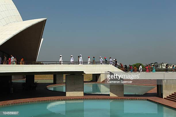 Tourists visit the The Baha'i House of Worship known as the 'Lotus Temple' ahead of the Delhi 2010 Commonwealth Games on September 30 2010 in Delhi...