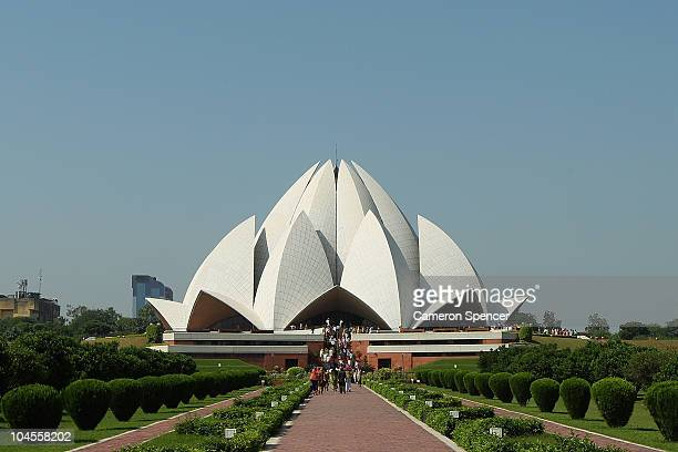 Tourists visit the The Bahá'i House of Worship known as the 'Lotus Temple' ahead of the Delhi 2010 Commonwealth Games on September 30 2010 in Delhi...