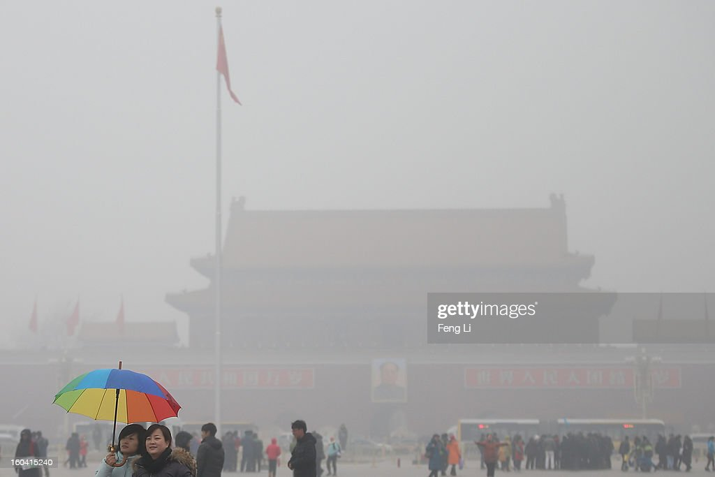 Tourists visit the Tiananmen Square during severe pollution on January 31, 2013 in Beijing, China. Heavy smog that has choked Beijing for the last five days weakened slightly on Thursday due to a light rainfall, although the capital's air remains heavily polluted. The haze choking many Chinese cities covers a total area of 1.43 million square kilometers, the China's Ministry of Environmental Protection said Wednesday.