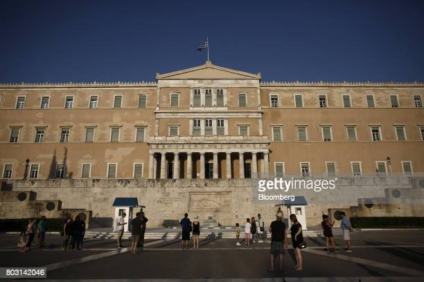Tourists visit the Tomb of the Unknown Soldier in front of the Greek parliament in Athens Greece on Wednesday June 28 2017 The change in sentiment...