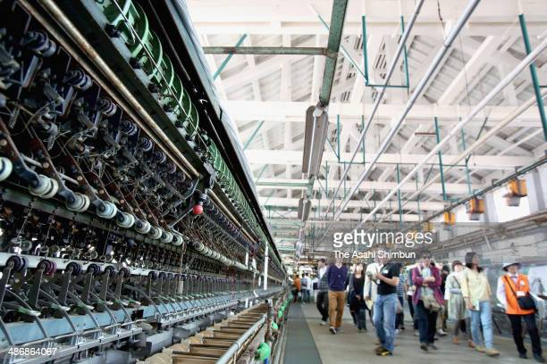 Tourists visit the Tomioka Silk Mill on April 26 2014 in Tomioka Gunma Japan Constructed by the Meiji government in 1872 the public silk reeling...