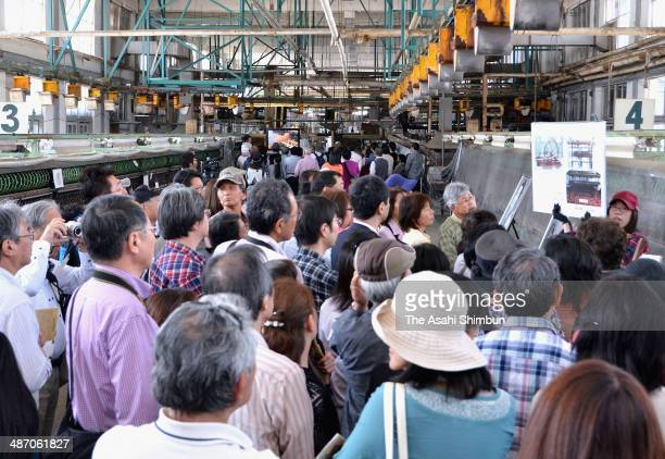 Tourists visit the Tomioka Silk Mill on April 26 2014 in Tomioka Gunma Japan Record high 4972 visitors stormed to the former silk plant a day after...