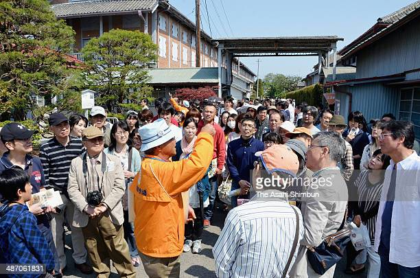 Tourists visit the Tomioka Silk Mill on April 27 2014 in Tomioka Gunma Japan Record high 4972 visitors stormed to the former silk plant a day after...