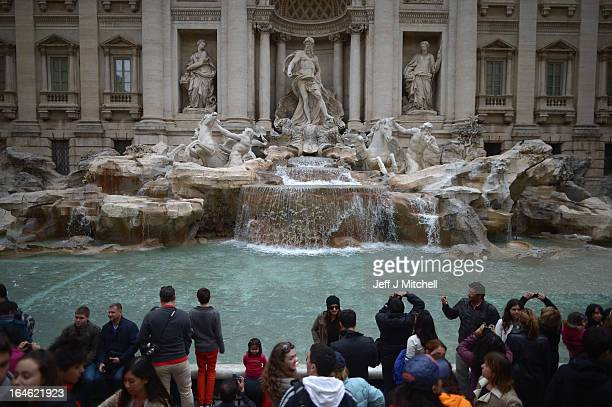 Tourists visit the Trevi Fountain on March 25 2013 in Rome Italy Pope Francis yesterday led his first mass of Holy Week as pontiff by celebrating...