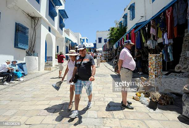 Tourists visit the village of Sidi Bou Said near Tunis on June 12 2012 Tunisian police arrested 90 people including Islamist hardliners over a series...