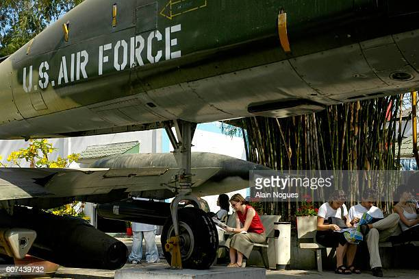 Tourists visit the War Remnants Museum in Saigon that houses exhibits including a UH1H helicopter a M48 tank a T7 bulldozer and military aircraft...