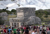 Tourists visit Tulum archaeological park 130 km south of Cancun Mexico on December 19 2012 Mexico is one of five countries preparing to celebrate on...