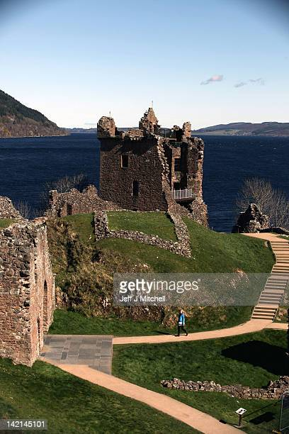 Tourists visit Urquhart Castle on Loch Ness on March 30 2012 in Drumnadrochit United Kingdom