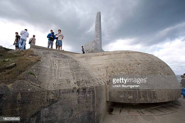 Tourists visiting a German bunker at Pointe du Hoc part of the coast during the landing of the allies in the Normandy At the top a memorial for the...