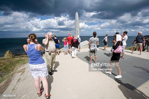Tourists visiting a memorial for the killed soldiers at Pointe du Hoc part of the coast during the landing of the allies in the Normandy on August...