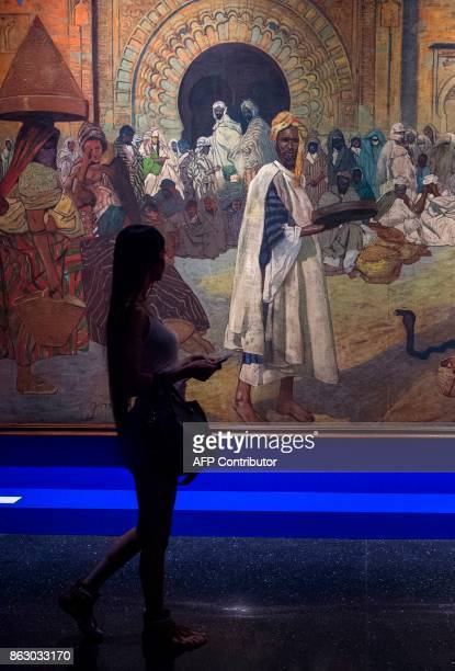 A tourists visits the new Yves Saint Laurent museum in the Moroccan city of Marrakesh on October 19 2017 A fusion of the Moroccan traditions and...