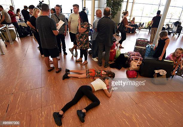 Tourists wait at the airport of Egypt's Red Sea resort of Sharm ElSheikh on November 6 2015 Britain moved to repatriate thousands of tourists from...