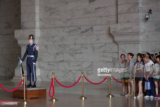 Tourists wait for the changing of the guard in the Chiang Kai Shek Memorial Hall in Taipei Taiwan on Wednesday July 24 2013 Taiwan President Ma...