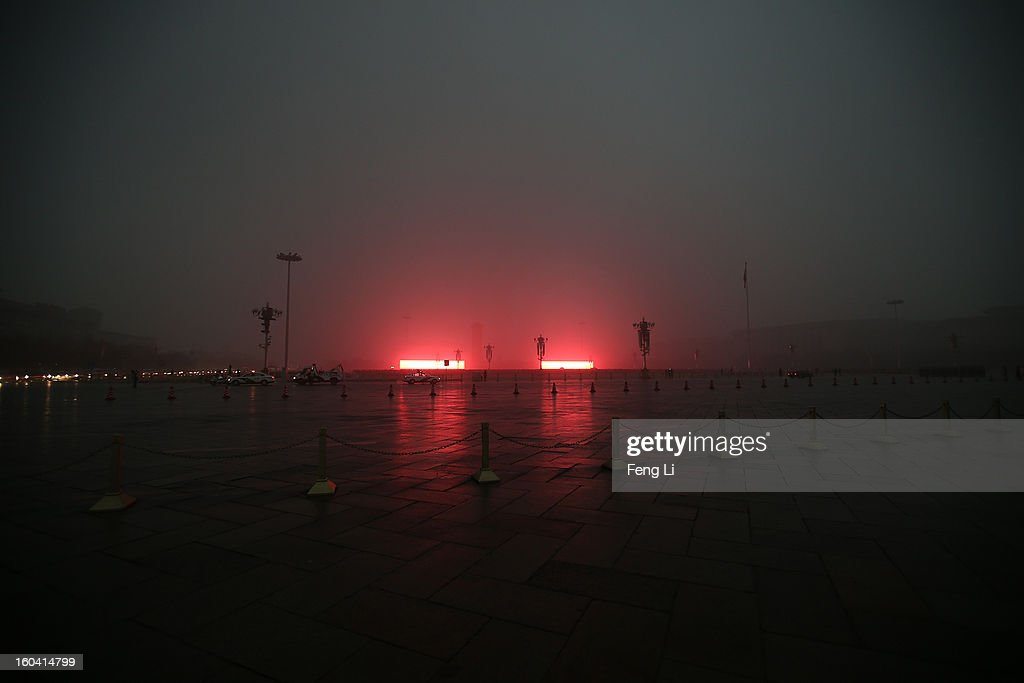 Tourists wait for the flag-raising ceremony in front of two LED screens on the Tiananmen Square during severe pollution on January 31, 2013 in Beijing, China. Heavy smog that has choked Beijing for the last five days weakened slightly on Thursday due to a light rainfall, although the capital's air remains heavily polluted. The haze choking many Chinese cities covers a total area of 1.43 million square kilometers, the China's Ministry of Environmental Protection said Wednesday.