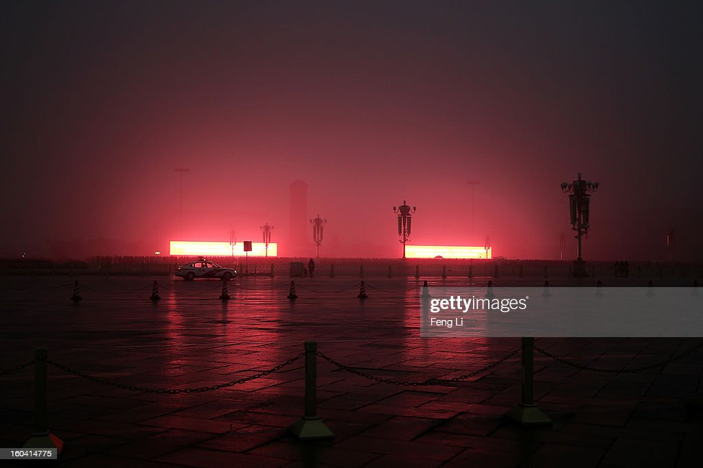Tourists wait for the flag-raising ceremony on the Tiananmen Square during severe pollution on January 31, 2013 in Beijing, China. Heavy smog that has choked Beijing for the last five days weakened slightly on Thursday due to a light rainfall, although the capital's air remains heavily polluted. The haze choking many Chinese cities covers a total area of 1.43 million square kilometers, the China's Ministry of Environmental Protection said Wednesday.