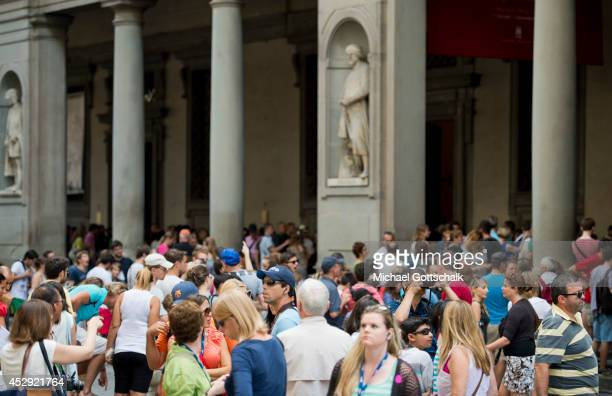 Tourists wait in front of Uffizi Gallery Museum on July 22 2014 in Florence Italy