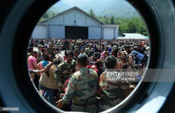Tourists wait to be evacuated by Indian Air Force helicopters during rescue and relief operations following flooding in Srinagar on September 10 2014...