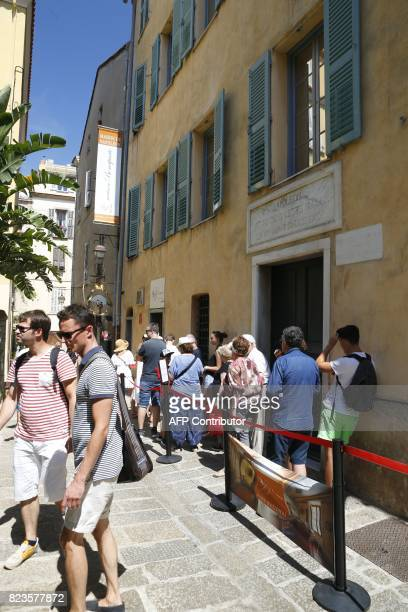 Tourists wait to visit the birthplace of Napoleon Bonaparte in central Ajaccio on the French Mediterranean island of Corsica on July 27 2017 Two...