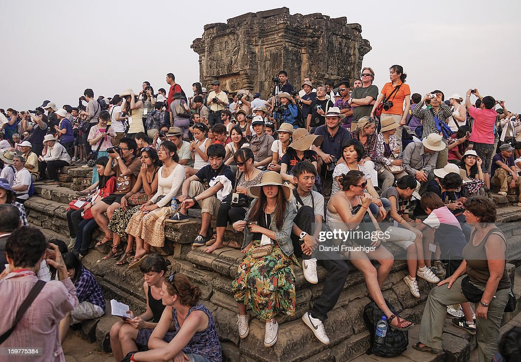 CONTENT] Tourists waiting for Sunset at Angkor Wat in Siem Reap, Cambodia. February 17, 2011.