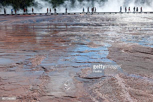 Tourists walk along a boardwalk,Grand Prismatic Springs,Yellowstone,Usa