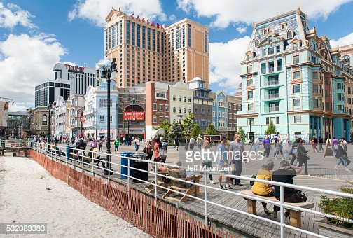Tourists walk along the boardwalk at Atlantic City, New Jersey.