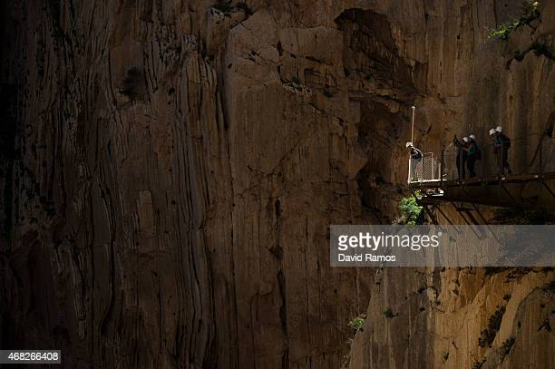 Tourists walk along the 'El Caminito del Rey' footpath on April 1 2015 in Malaga Spain 'El Caminito del Rey' which was built in 1905 and winds...