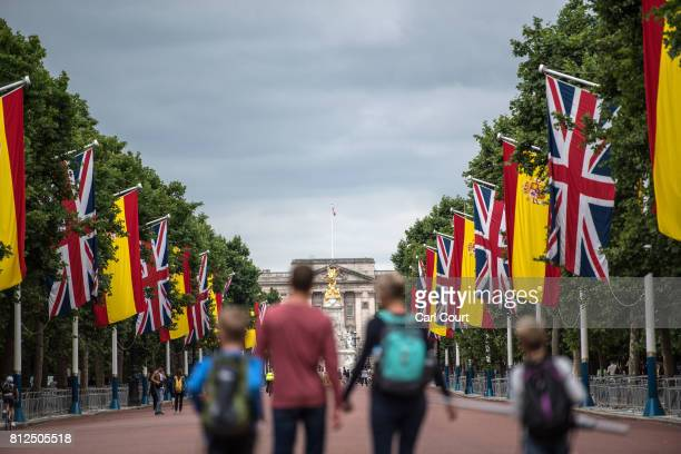 Tourists walk along The Mall where Spanish flags have been hung alongside Union Flags ahead of the state visit by King Felipe and Queen Letizia of...