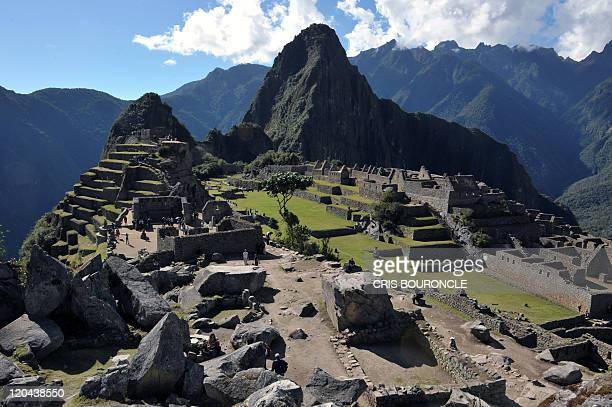 Tourists walk among the ruins of the Machu Picchu citadel 130 km northwest of Cusco Peru on July 6 2011 The Inca compound is being prepared for the...