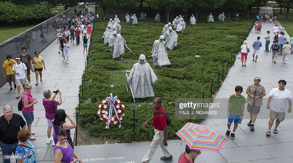 Tourists walk around the Korean War Memorial August 11 2012 in Washington DC AFP PHOTO/Paul J Richards