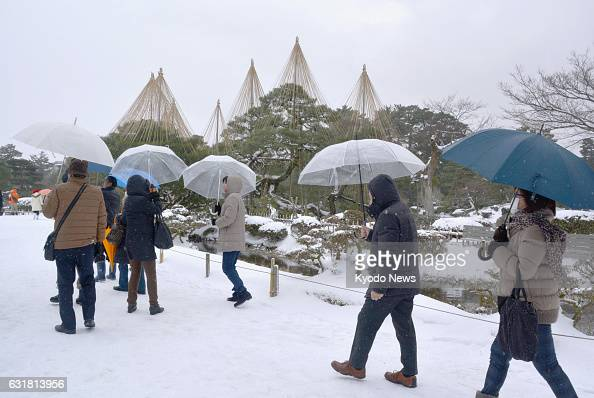 Tourists walk at a snowcovered Kenrokuen in Kanazawa Ishikawa Prefecture one of the 'Three Great Gardens' of Japan on Jan 15 2017 Temperatures...