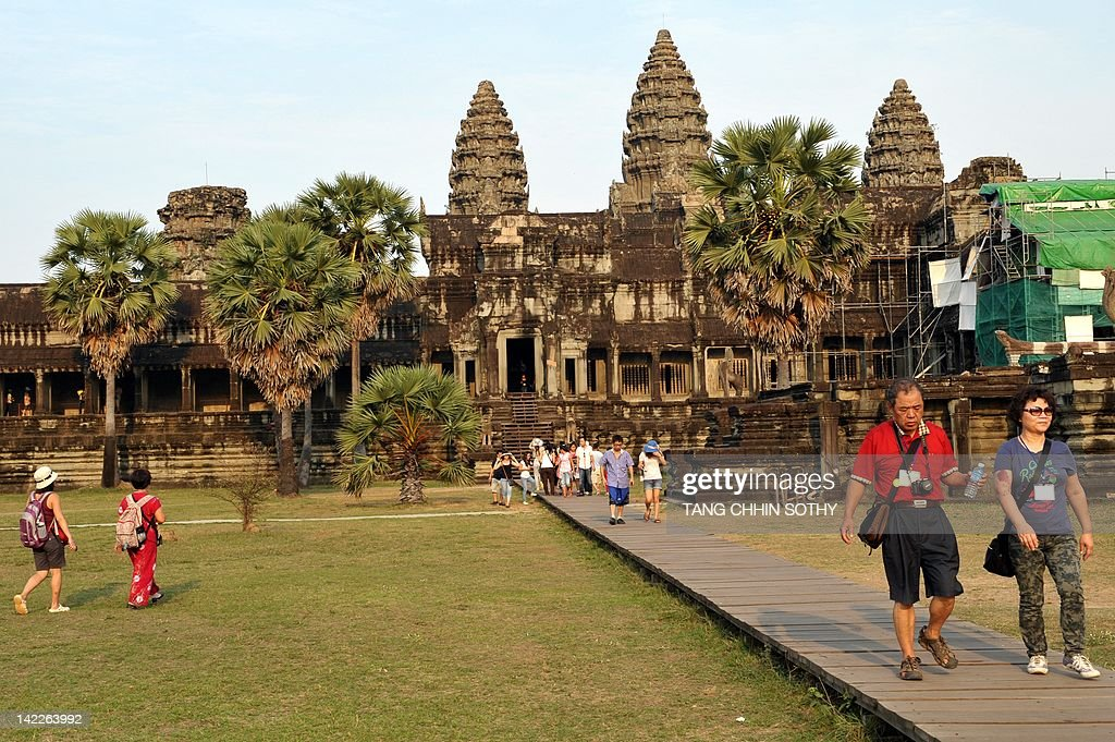 Tourists walk at Angkor Wat temple in Siem Reap Province, some 300 kilometers northwest of Phnom Penh on April 1, 2012. Visitors to Angkor National Park topped 1.15 million people in 2010, up 25 percent on the year before.
