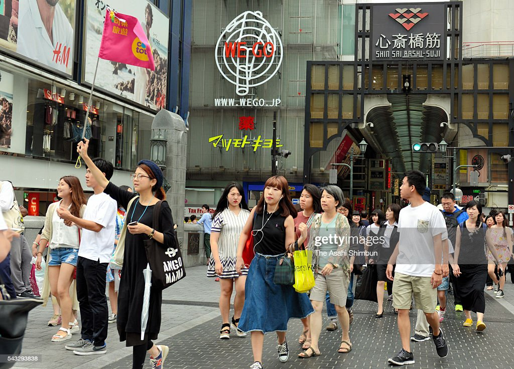 Tourists walk at Dotonbori area on June 27, 2016 in Osaka, Japan. Japanese government and the central bank held a meeting to measure the impact of the 'Brexit'.