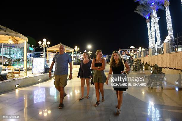 Tourists walk at Sharm elSheikh on November 7 2015 Britain moved to repatriate thousands of tourists from Egypt's Sharm elSheikh after warnings a...