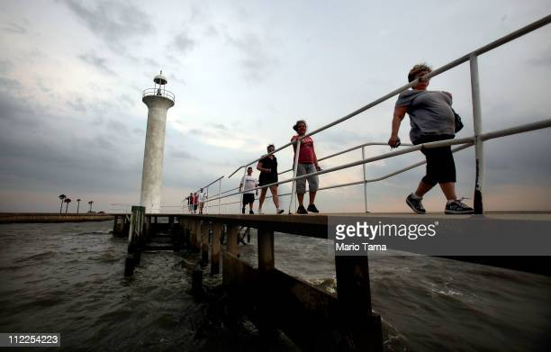 Tourists walk away from the Biloxi Lighthouse on the Gulf of Mexico April 15 2011 in Biloxi Mississippi BP says it has made tourism payments of $18...