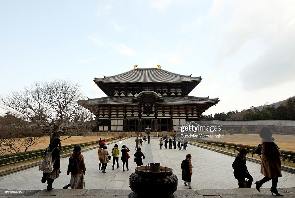 Tourists walk front of the main building of the Todaiji Temple on March 2, 2013 in Nara, Japan. The Buddhist Todaiji Temple was built in 752 AD and is now one of seven sites in Nara to be listed as a UNESCO World Heritage Site.